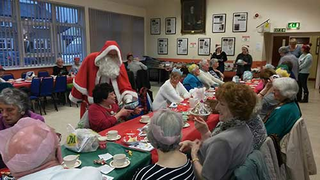 Santa Claus hands out presents at the Village Unite event