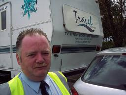 A BBC Security guard is surprised after film crew trailors were mistaken for illegal travellers' caravans
