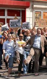 Lib Dem Councillors, activists and members of the public waggle their toes in protest at the closure of Buersil Post Office during a barefoot protest march earlier this month