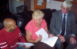 Plan of action: Buersil Post master Jay Patel, resident Carol Hoye and Rochdale MP Paul Rowen go through their plans to try and save their local Post Office