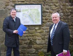 Councillor Dale Mulgrew alongside John Miller – Chief Executive of the Heritage Trust for the North West – outside the Pendle Heritage Centre